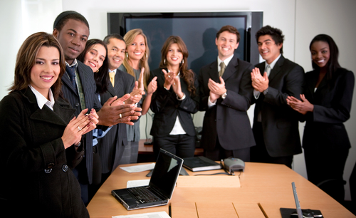 Successful business team at the office applauding